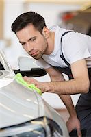 Young maintenance engineer cleaning car in repair shop Stock Photo - Premium Royalty-Freenull, Code: 693-07672931