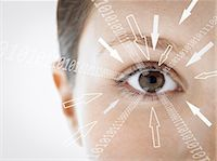 Close-up portrait of businesswoman with binary digits and arrow signs moving towards her eye against white background Stock Photo - Premium Royalty-Freenull, Code: 693-07673289