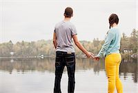 Teen couple holding hands by a lake Stock Photo - Premium Royalty-Freenull, Code: 613-07673901
