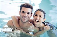 swimming pool water - Young couple in pool together, portrait Stock Photo - Premium Royalty-Freenull, Code: 632-07674453