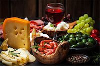 Antipasto and catering platter with different meat and cheese products Stock Photo - Royalty-Freenull, Code: 400-07678623