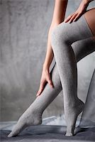 stocking feet - Beautiful woman legs in grey stockings Stock Photo - Royalty-Freenull, Code: 400-07678907
