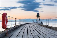 fishing - United Kingdom, England, North Yorkshire, Whitby. The West Pier at dusk. Stock Photo - Premium Rights-Managed, Artist: AWL Images, Code: 862-07689973