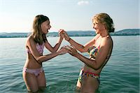 preteen bikini - Mother and daughter playing in lake Stock Photo - Premium Royalty-Freenull, Code: 6122-07693618