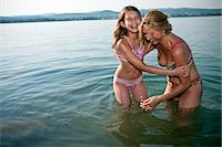 Mother and daughter laughing in lake Stock Photo - Premium Royalty-Freenull, Code: 6122-07693619
