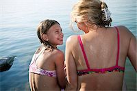 preteen swim - Mother and daughter chatting by lake Stock Photo - Premium Royalty-Freenull, Code: 6122-07693620