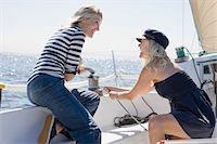 sailboat  ocean - Smiling women sailing on boat Stock Photo - Premium Royalty-Freenull, Code: 6122-07694032