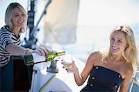 sailboat  ocean - Women drinking wine on boat Stock Photo - Premium Royalty-Freenull, Code: 6122-07694041