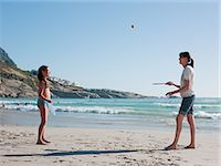 Mother and daughter playing paddleball on beach Stock Photo - Premium Royalty-Freenull, Code: 6122-07694563