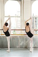 Rear view of ballerinas raising legs Stock Photo - Premium Royalty-Freenull, Code: 6122-07695415