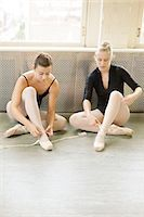 Ballerinas putting on ballet slippers Stock Photo - Premium Royalty-Freenull, Code: 6122-07695438