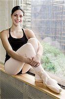 Ballerina sitting in windowsill Stock Photo - Premium Royalty-Freenull, Code: 6122-07695439