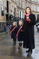 family shoes - Mother and two daughters standing on pavement Stock Photo - Premium Royalty-Freenull, Code: 6122-07695818