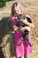 preteen girl pussy - Girl holding cat, portrait Stock Photo - Premium Royalty-Freenull, Code: 6122-07696747