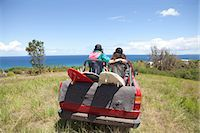 Off road vehicle driving toward beach with two women in back Stock Photo - Premium Royalty-Freenull, Code: 6122-07696947