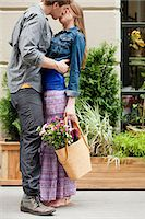 Young couple kissing outdoors Stock Photo - Premium Royalty-Freenull, Code: 6122-07697420