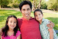 filipino - Man with son and daughter in park, portrait Stock Photo - Premium Royalty-Freenull, Code: 6122-07697505