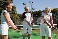 Senior and mature adults practising on tennis courts Stock Photo - Premium Royalty-Freenull, Code: 6122-07697841