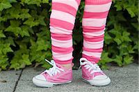 Legs of a toddler in pink striped leggings Stock Photo - Premium Royalty-Freenull, Code: 6122-07697853