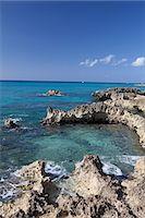Rocks and Caribbean Sea, Grand Cayman, Cayman Islands Stock Photo - Premium Royalty-Freenull, Code: 6122-07697985