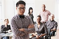 filipino - Portrait of businessman with colleagues in background Stock Photo - Premium Royalty-Freenull, Code: 6122-07698166