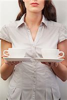 Young woman holding two teacups Stock Photo - Premium Royalty-Freenull, Code: 6122-07698223