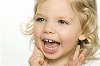 Close up of girl smiling Stock Photo - Premium Royalty-Freenull, Code: 6122-07698741