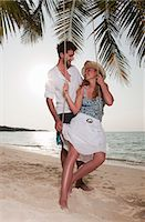 Couple playing on swing at beach Stock Photo - Premium Royalty-Freenull, Code: 6122-07699009