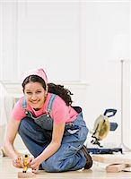 Woman using power tools at home Stock Photo - Premium Royalty-Freenull, Code: 6122-07699180