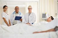 Doctors and nurse in hospital room Stock Photo - Premium Royalty-Freenull, Code: 6122-07699189