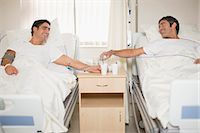 Patients talking in hospital beds Stock Photo - Premium Royalty-Freenull, Code: 6122-07699192
