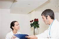 Doctor and nurse talking in hospital Stock Photo - Premium Royalty-Freenull, Code: 6122-07699199
