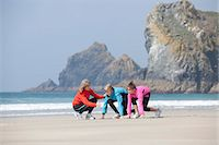 preteen girls stretching - Family running together on beach Stock Photo - Premium Royalty-Freenull, Code: 6122-07699278