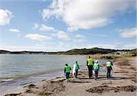 preteen beach - Boys in safety vests cleaning beach Stock Photo - Premium Royalty-Freenull, Code: 6122-07699890