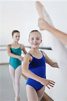Ballet dancers posing at barre Stock Photo - Premium Royalty-Freenull, Code: 6122-07700322