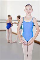 preteen beauty - Ballet dancer standing in studio Stock Photo - Premium Royalty-Freenull, Code: 6122-07700326