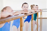 Ballet dancers standing at barre Stock Photo - Premium Royalty-Freenull, Code: 6122-07700329
