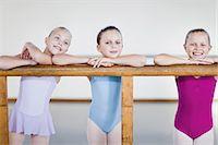 preteen dancing - Ballet dancers standing at barre Stock Photo - Premium Royalty-Freenull, Code: 6122-07700335