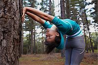 flexible (people or objects with physical bendability) - Runner stretching in forest Stock Photo - Premium Royalty-Freenull, Code: 6122-07700491