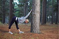 stretching (people exercising) - Runner stretching in forest Stock Photo - Premium Royalty-Freenull, Code: 6122-07700493