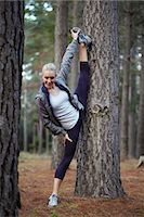 stretching (people exercising) - Runner stretching in forest Stock Photo - Premium Royalty-Freenull, Code: 6122-07700501
