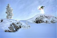 Snowboarder jumping from hillside Stock Photo - Premium Royalty-Freenull, Code: 6122-07700535
