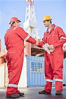 platform - Workers shaking hands on oil rig Stock Photo - Premium Royalty-Freenull, Code: 6122-07700869