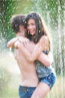 preteen girl boyfriends - Friends hugging in sprinkler Stock Photo - Premium Royalty-Freenull, Code: 6122-07702069
