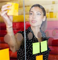 self adhesive note - Businesswoman sticking notes on window Stock Photo - Premium Royalty-Freenull, Code: 6122-07702389
