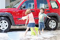 Children playing and washing car Stock Photo - Premium Royalty-Freenull, Code: 6122-07703083