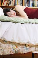 Woman sleeping on bed Stock Photo - Premium Royalty-Freenull, Code: 6122-07703199