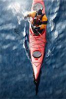 Aerial view of kayaker in water Stock Photo - Premium Royalty-Freenull, Code: 6122-07703270