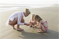 Mother and children playing on beach Stock Photo - Premium Royalty-Freenull, Code: 6122-07703287