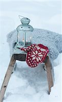 Mittens and lantern in snowy field Stock Photo - Premium Royalty-Freenull, Code: 6122-07703304